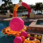arch of floaties swimming pool celebration around Maryland Manor