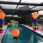 swimming pool party balloon pool floaty installation around Westshore Palms
