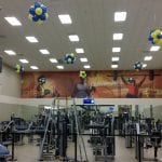 gym balloon decorations on ceiling to greet guests as they workout
